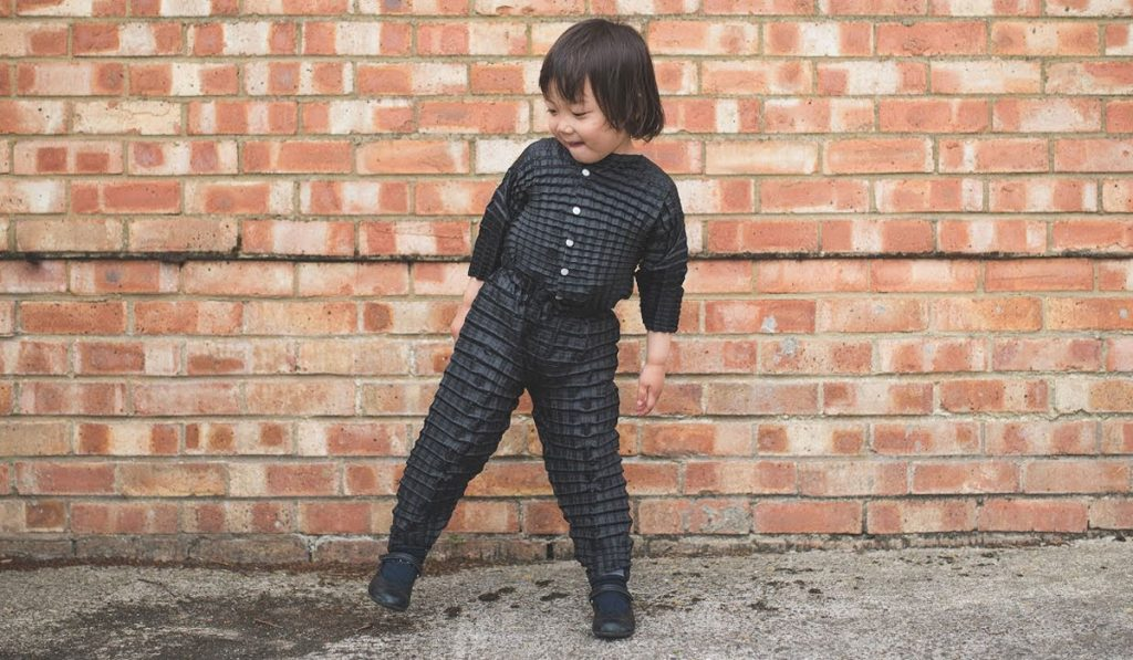 Ryan Yasin's, Petit Pli - Origami-inspired range of children's clothing made from a durable pleated fabric that expands to fit growing babies.